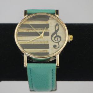 Horloge goudkleurige kast pianotoetsen g-sleutel groene band gadgets voor gitaar en muziek cadeau kind