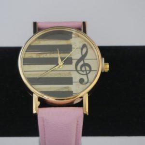 Horloge goudkleurige kast pianotoetsen g-sleutel roze band gadgets voor gitaar en muziek cadeau kind