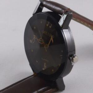 Horloge met muziek tekens op wijzerplaat